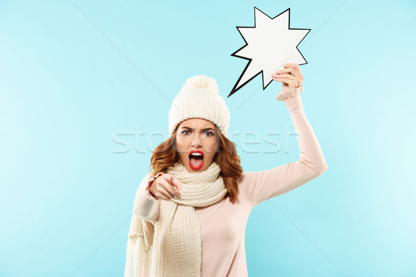 Portrait of an angry furious girl dressed in winter clothes Stock photo © deandrobot