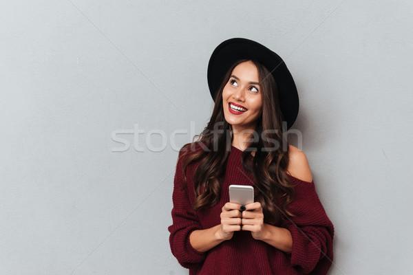 Encantador negro sombrero de punto suéter Foto stock © deandrobot