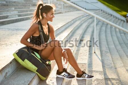 Portré mosolyog fülhallgató ül lépcsősor kint Stock fotó © deandrobot