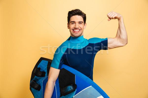 портрет счастливым молодым человеком купальник бицепс Сток-фото © deandrobot