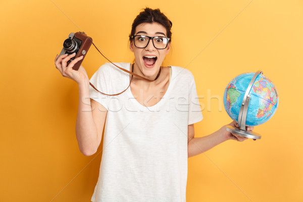 Excited young pretty woman tourist Stock photo © deandrobot