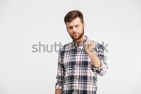 портрет сердиться молодым человеком кулаком изолированный белый Сток-фото © deandrobot