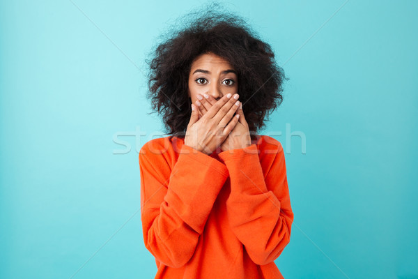 Image of shocked woman 20s in casual clothing looking on camera  Stock photo © deandrobot