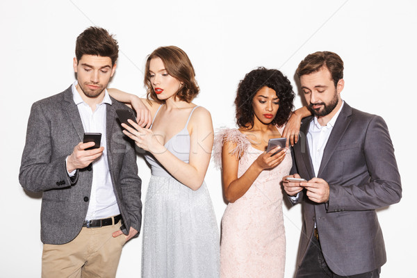 Group of bored well dressed multiracial people Stock photo © deandrobot