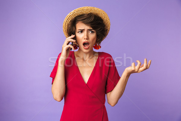 Shocked Pretty brunette woman in dress and straw hat Stock photo © deandrobot