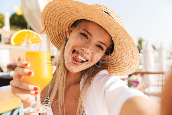 Joyful young girl in summer hat and swimwear Stock photo © deandrobot
