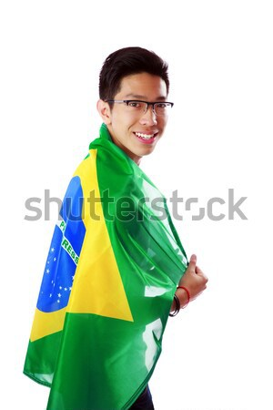 Side view portrait of a man holding Brazilian flag over white background Stock photo © deandrobot