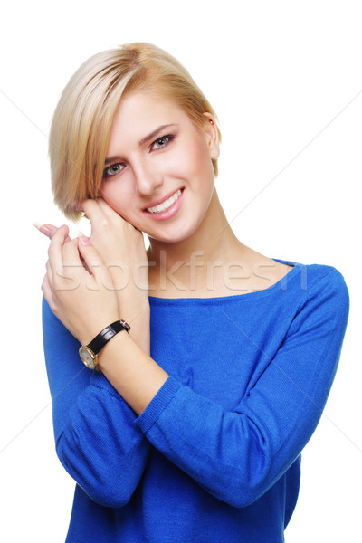 Young beautiful woman touching her face isolated on white background Stock photo © deandrobot