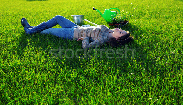 Beautiful woman lying on green grass Stock photo © deandrobot