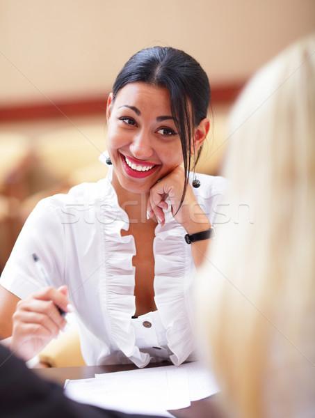 Nevet nő ül üzleti megbeszélés kollégák iroda Stock fotó © deandrobot