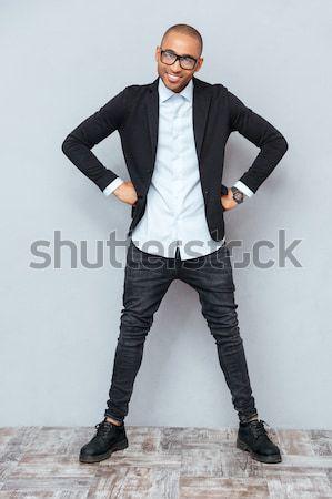 Portré dühös üzletember teljes alakos szürke iroda Stock fotó © deandrobot