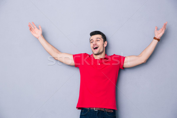 Happy man welcoming you with his arms open Stock photo © deandrobot