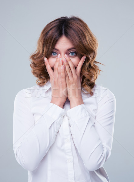 Businesswoman covering her face with palms Stock photo © deandrobot