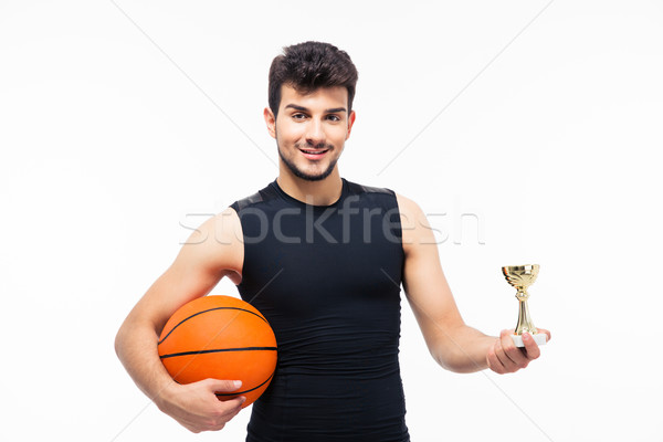 Basketball player holding winners cup Stock photo © deandrobot