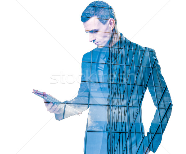 Double exposure of a businessman holding a tablet and an office building over white background Stock photo © deandrobot