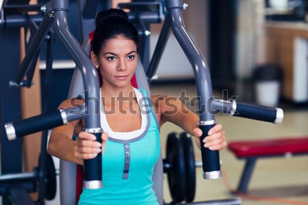 Sports woman doing abs exercises Stock photo © deandrobot