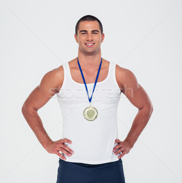 Portrait souriant sport homme permanent médaille Photo stock © deandrobot