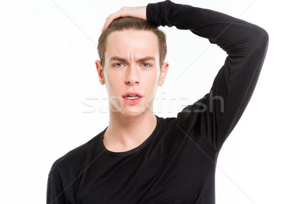 Ritratto triste uomo toccare testa isolato Foto d'archivio © deandrobot