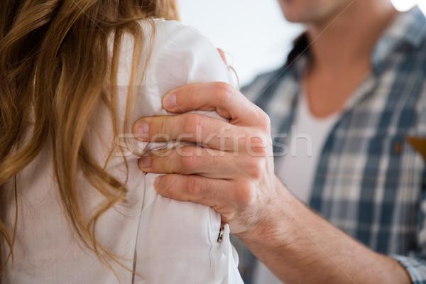Homem mão mulher ombro casa Foto stock © deandrobot