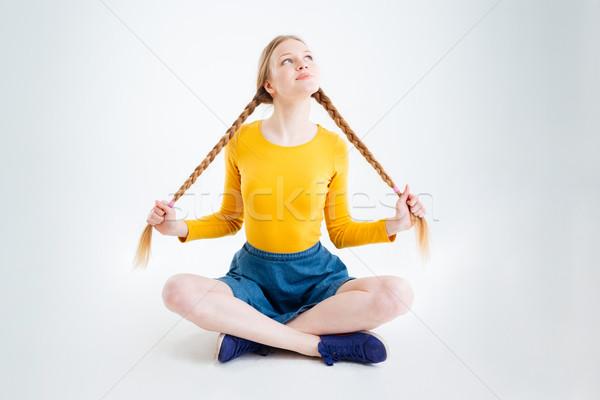 Boldog figyelmes lány ül padló felfelé néz Stock fotó © deandrobot