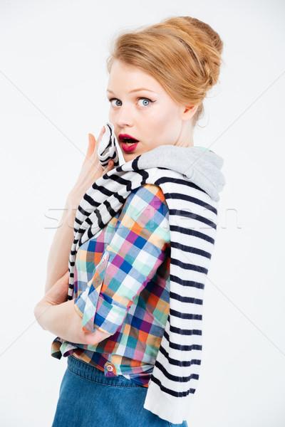 Maravilhado mulher olhando câmera isolado branco Foto stock © deandrobot