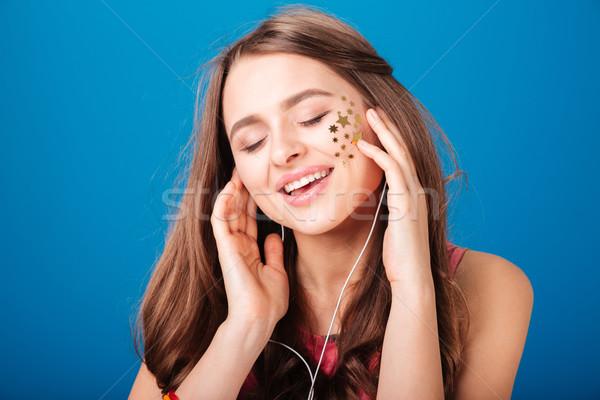 Eccitato tenero ascoltare musica cantare Foto d'archivio © deandrobot