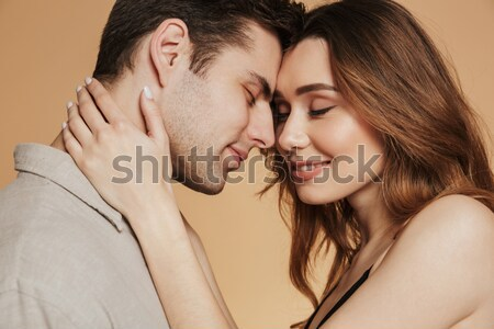 Close-up portrait of a beautiful kissing couple in bed Stock photo © deandrobot