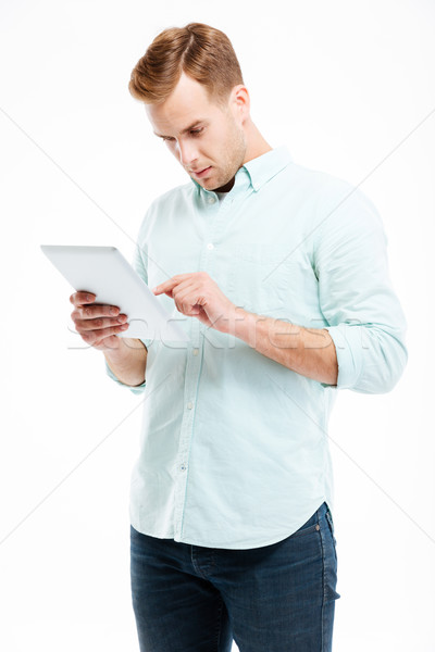 Portrait of a young man using tablet computer Stock photo © deandrobot