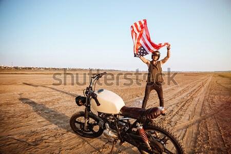 Uomo indossare americano casco Foto d'archivio © deandrobot