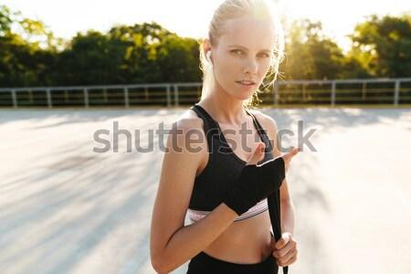 счастливым женщину купальник Солнцезащитные очки танцы улице Сток-фото © deandrobot