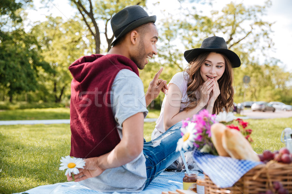 Couple having picnic and flirting in park Stock photo © deandrobot