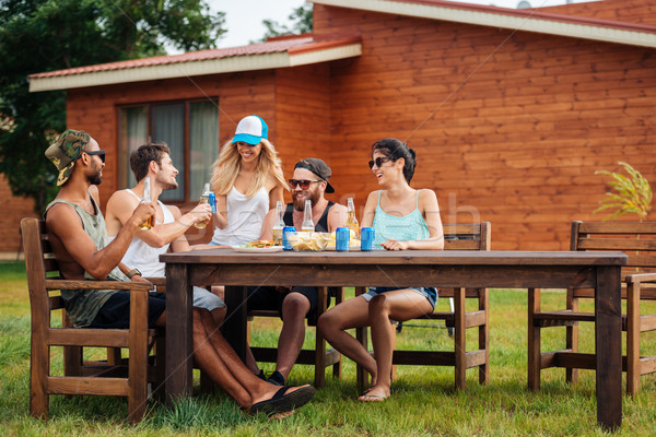 улыбаясь люди питьевой пива соды таблице Сток-фото © deandrobot