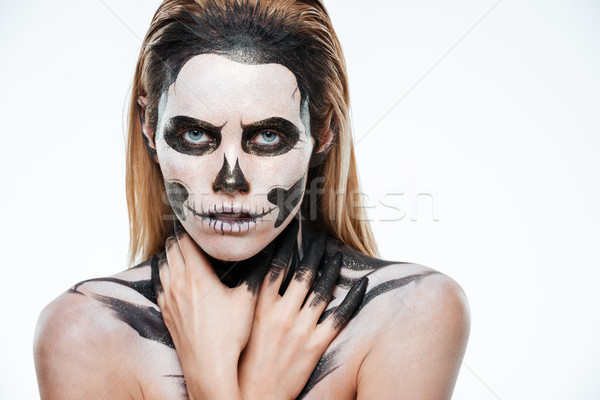 Portrait of girl with fearful skeleton makeup Stock photo © deandrobot