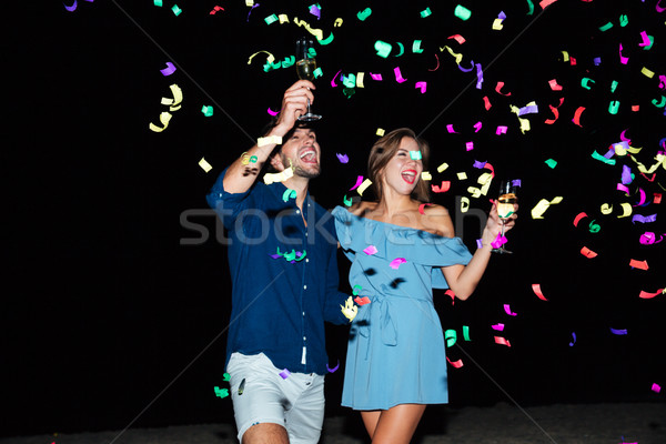 Couple drinking champagne and celebrating at night Stock photo © deandrobot
