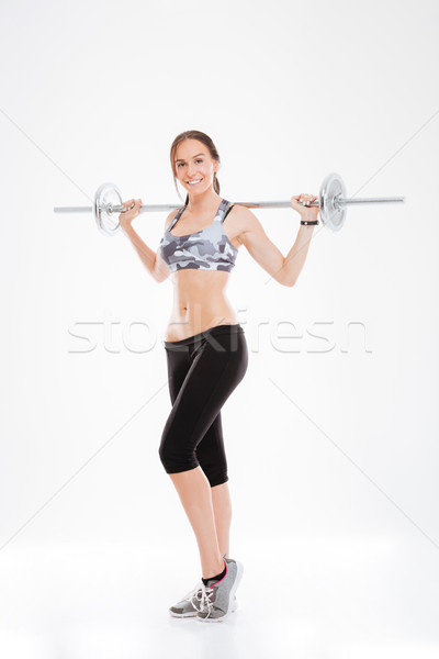 Full length fitness girl with barbell Stock photo © deandrobot