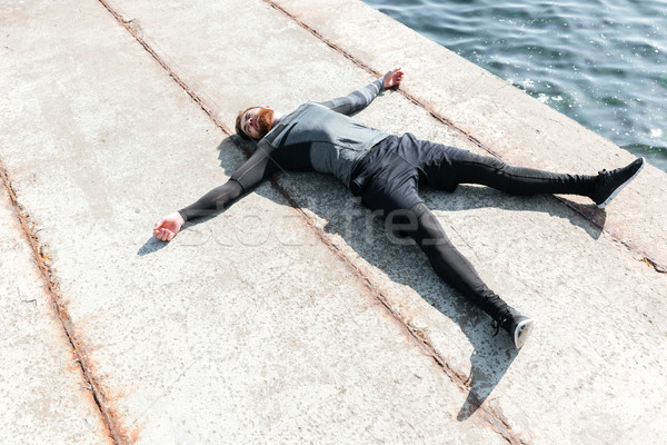 Male lying on the dock Stock photo © deandrobot
