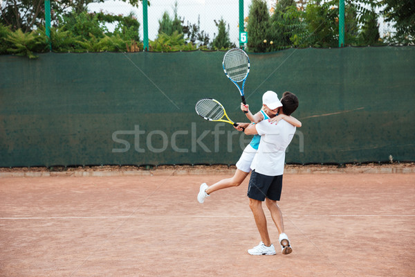 Happy won tennis players Stock photo © deandrobot