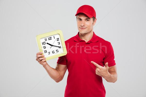 Futár óra tart helyes kéz izolált Stock fotó © deandrobot
