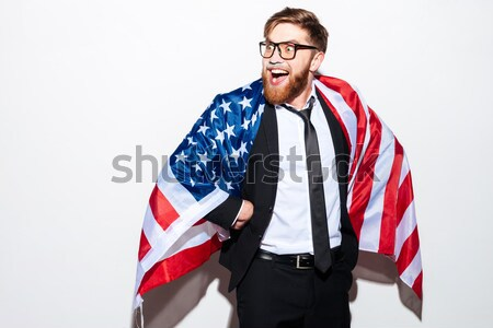 Patriotic business man with flag Stock photo © deandrobot