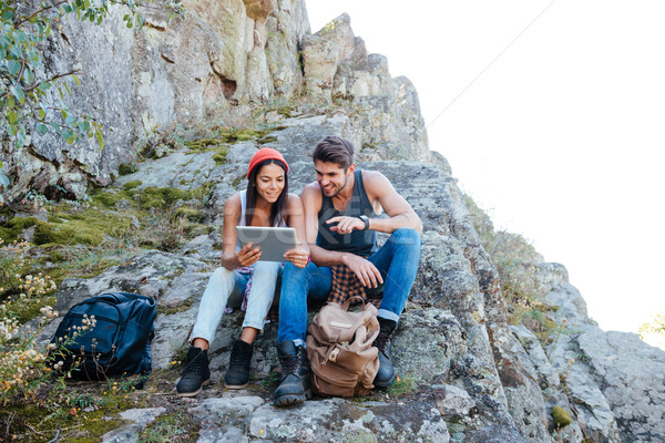 Couple resting and using tablet computer Stock photo © deandrobot