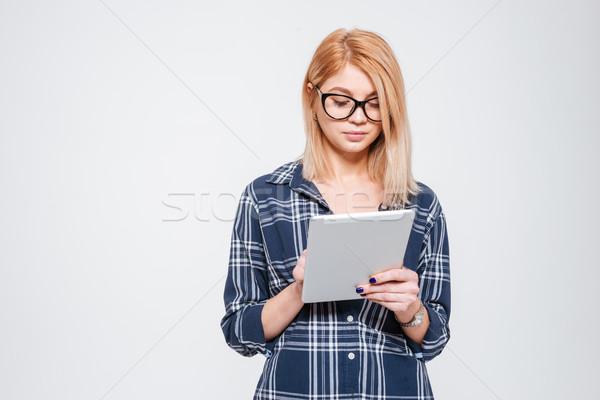 信じられない 女性 着用 眼鏡 タブレット ストックフォト © deandrobot