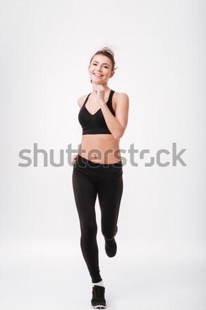 Retrato feliz deportes mujer ejecutando Foto stock © deandrobot