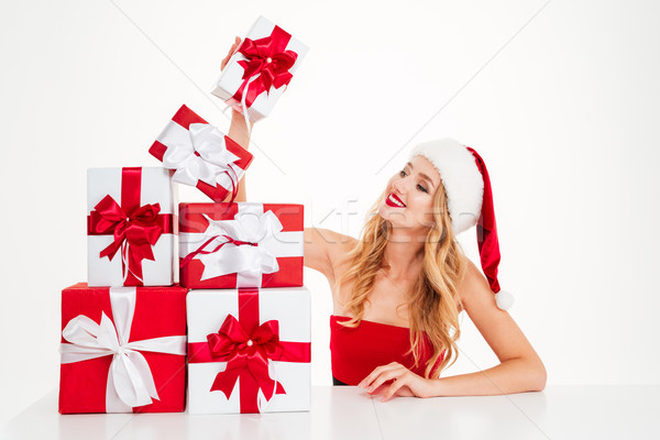 Happy young woman in santa claus costume with gift boxes Stock photo © deandrobot