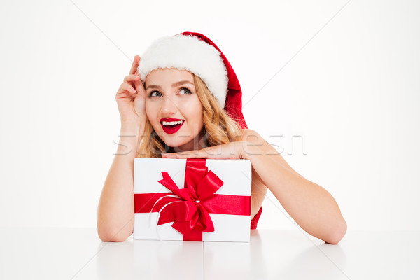 Happy woman in santa claus costume holding with present box Stock photo © deandrobot