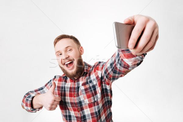 Feliz barbudo homem camisas Foto stock © deandrobot
