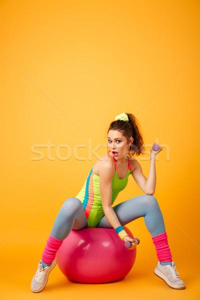 şaşırtıcı genç fitness woman poz sarı fotoğraf Stok fotoğraf © deandrobot