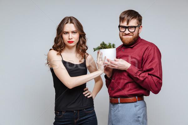 мужчины NERD представляет завода недовольный девушки Сток-фото © deandrobot