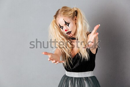 Happy woman which winks Stock photo © deandrobot