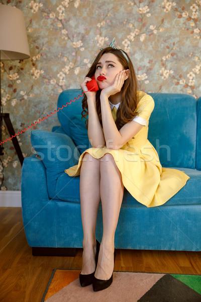 Nudzić młodych pinup pani mówić telefonu Zdjęcia stock © deandrobot