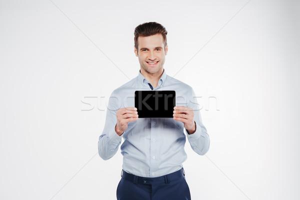 Gülen iş adamı ekran bakıyor Stok fotoğraf © deandrobot